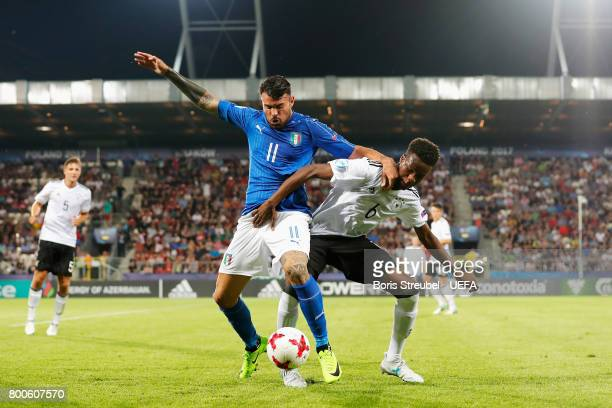 Andrea Petagna of Italy and Gideon Jung of Germany battle for the ball during the 2017 UEFA European Under21 Championship Group C match between Italy...
