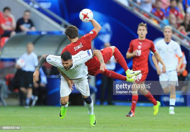 Andrea Petagna of Italy and Stefan Simic of Czech Republic battle for possession during the UEFA European Under21 Championship Group C match between...