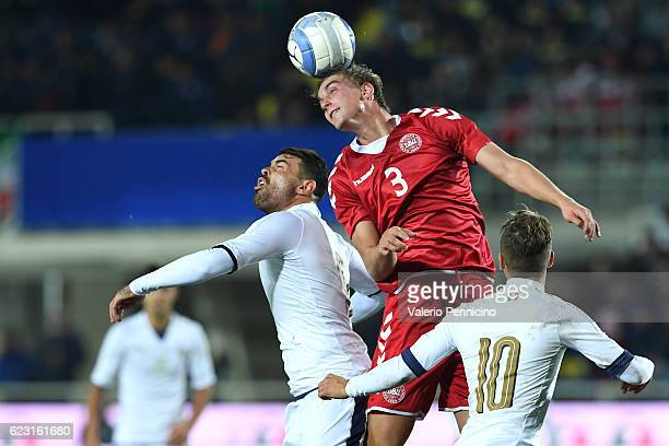 Andrea Petagna of Italy goes up with Andreas Maxso of Denmark during the International Friendly match between Italy U21 and Denmark U21 at Stadio...