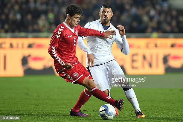 Andrea Petagna of Italy is challenged by Christian Norggaard of Denmark during the International Friendly match between Italy U21 and Denmark U21 at...