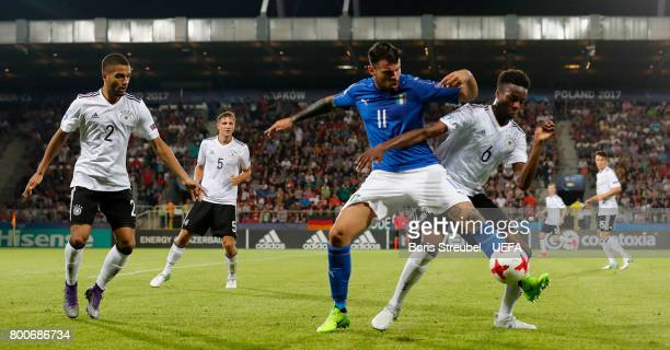 Andrea Petagna of Italy is challenged by Gideon Jung of Germany during the UEFA European Under21 Championship Group C match between Italy and Germany...