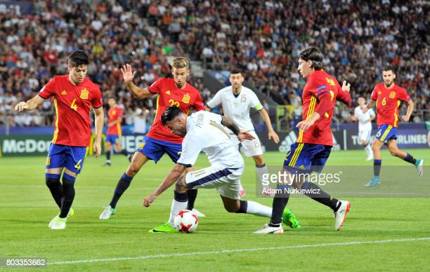 Andrea Petagna of Italy takes on the Spain defence during the UEFA European Under21 Championship Semi Final match between Spain and Italy at Krakow...