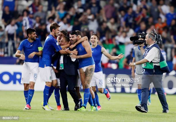 Andrea Petagna of Italy without jersey and pants celebrates after the victory during the UEFA U21 championship match between Italy and Germany at...