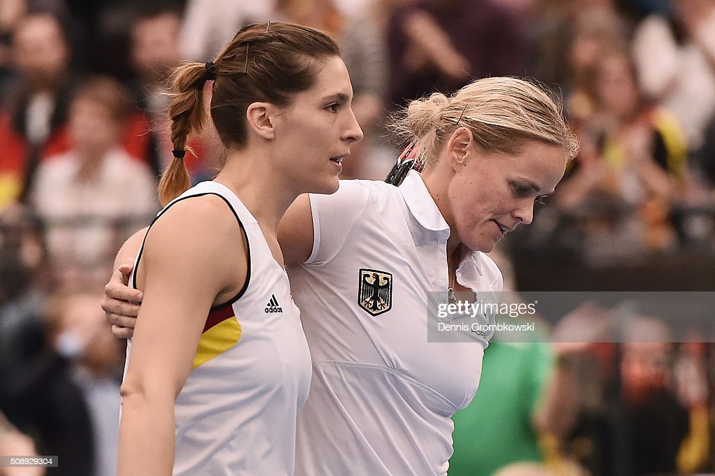 <a gi-track='captionPersonalityLinkClicked' href=/galleries/search?phrase=Andrea+Petkovic&family=editorial&specificpeople=4253746 ng-click='$event.stopPropagation()'>Andrea Petkovic</a> and <a gi-track='captionPersonalityLinkClicked' href=/galleries/search?phrase=Anna-Lena+Groenefeld&family=editorial&specificpeople=193798 ng-click='$event.stopPropagation()'>Anna-Lena Groenefeld</a> of Germany look dejected in their double match against Martina Hingis and Belinda Bencic of Switzerland on Day 2 of the 2016 FedCup World Group Round 1 match between Germany and Switzerland at Messe Leipzig on February 7, 2016 in Leipzig, Germany.