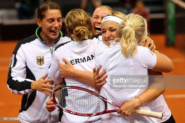 Andrea Petkovic Mona Barthel AnnaLena Groenefeld Sabine Lisicki and Germany`s team captain Barbara Rittner of team Germany celebrate victory after...