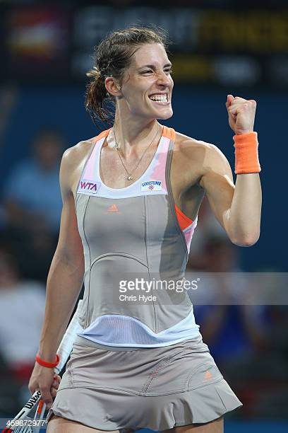 Andrea Petkovic of Germany celebrates after winning her match against Bethanie MattekSands of the USA during day one of the 2014 Brisbane...