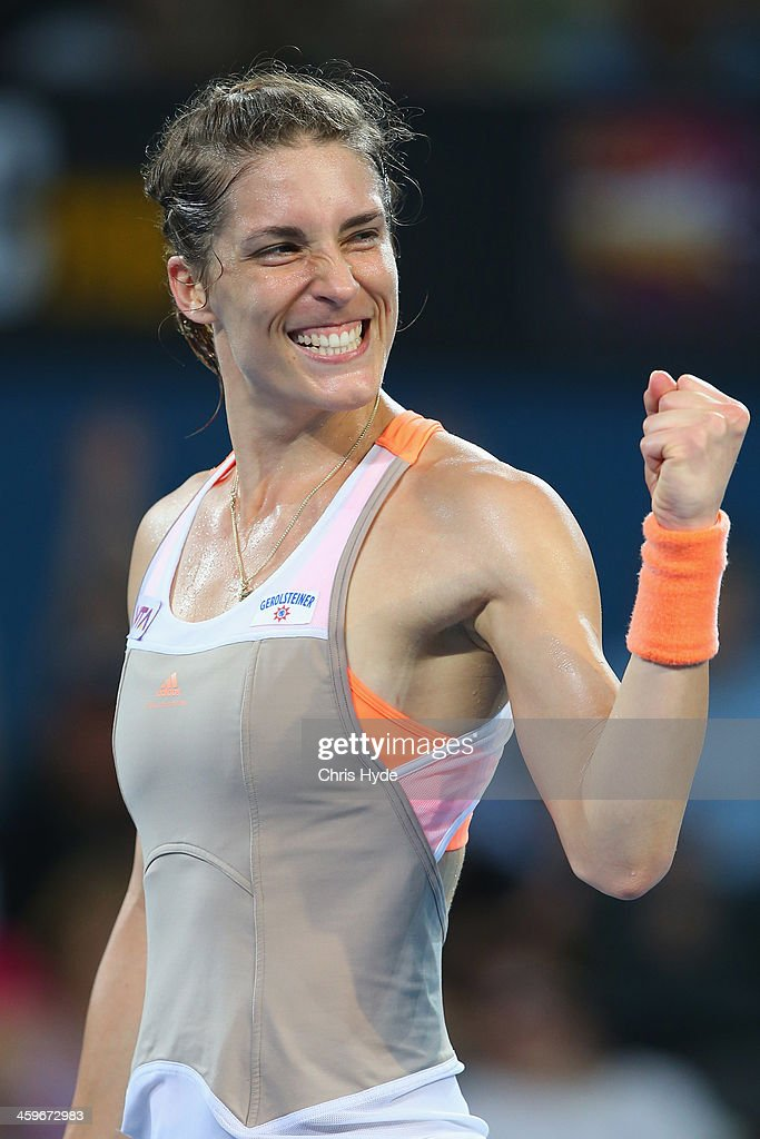 <a gi-track='captionPersonalityLinkClicked' href=/galleries/search?phrase=Andrea+Petkovic&family=editorial&specificpeople=4253746 ng-click='$event.stopPropagation()'>Andrea Petkovic</a> of Germany celebrates after winning her match against Bethanie Mattek-Sands of the USA during day one of the 2014 Brisbane International at Queensland Tennis Centre on December 29, 2013 in Brisbane, Australia.