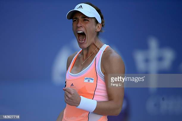 Andrea Petkovic of Germany celebrates during her women's singles match against Svetlana Kuznetsova of Russia on day five of the 2013 China Open at...