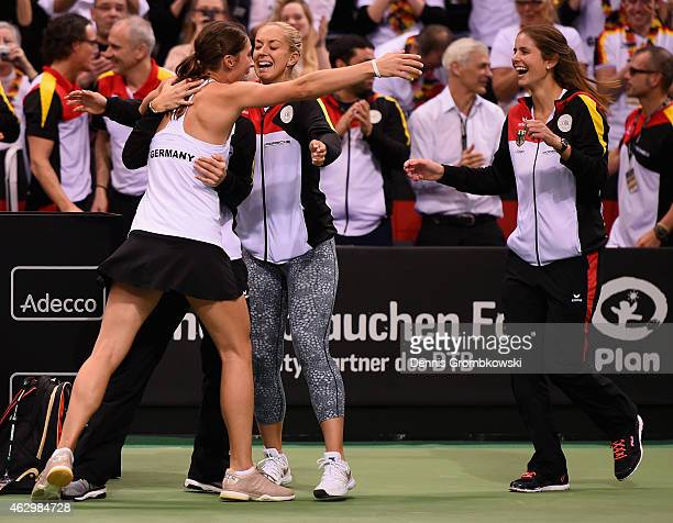 Andrea Petkovic of Germany celebrates with team mates after her victory in her single match against Jarmila Gajdosova of Australia during the Fed Cup...