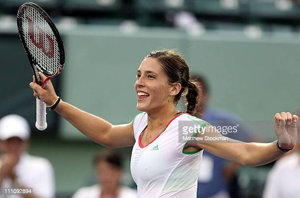 Andrea Petkovic of Germany dances in celebration of her win against Jelena Jankovic of Serbia during the Sony Ericsson Open at Crandon Park Tennis...