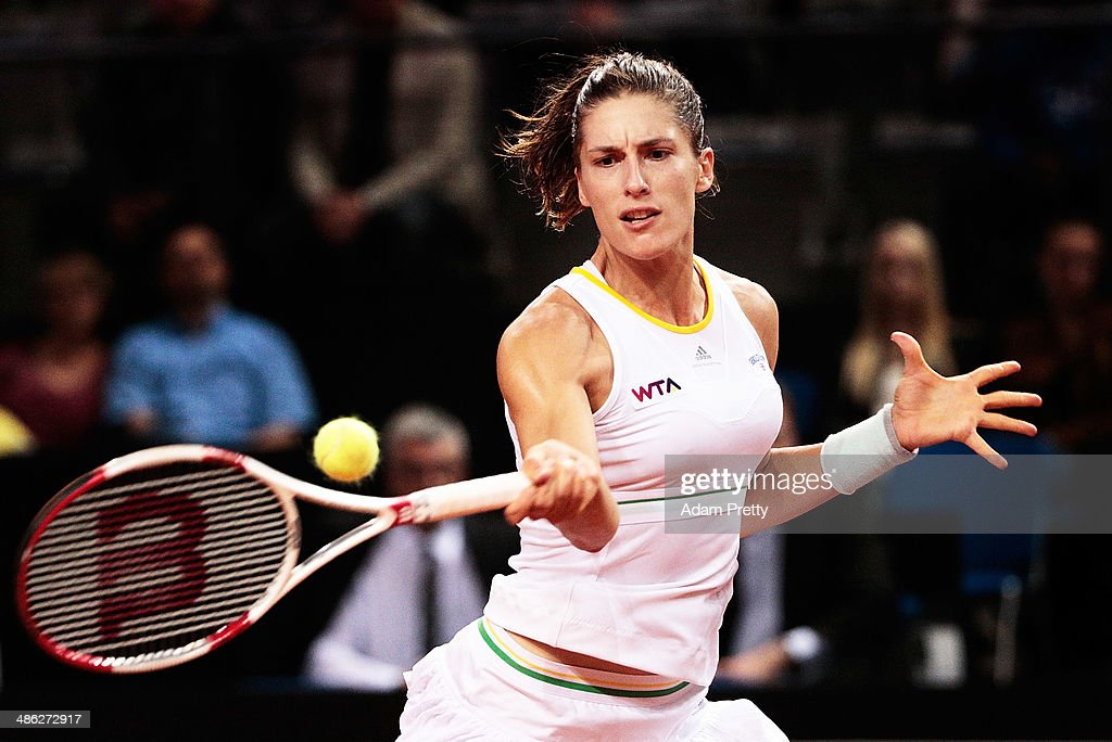 <a gi-track='captionPersonalityLinkClicked' href=/galleries/search?phrase=Andrea+Petkovic&family=editorial&specificpeople=4253746 ng-click='$event.stopPropagation()'>Andrea Petkovic</a> of Germany hits a forehand during her match against Flavia Pennetta of Italy during day 3 of the Porsche Tennis Grand Prix 2014 at Porsche-Arena on April 23, 2014 in Stuttgart, Germany.