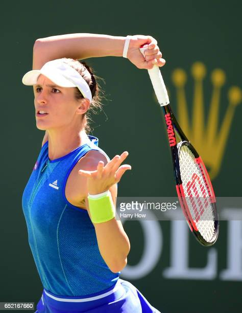 Andrea Petkovic of Germany hits a forehand during her straight set loss to Angelique Kerber of Germany at Indian Wells Tennis Garden on March 11 2017...
