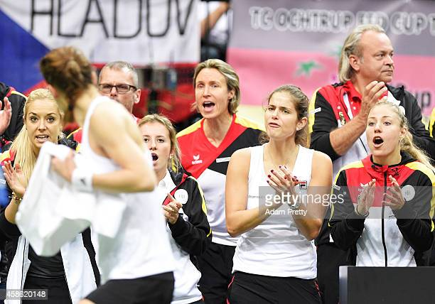 Andrea Petkovic of Germany is cheered on by team mates during the first rubber of the Fed Cup Final between Petra Kvitova of the Czech Republic and...