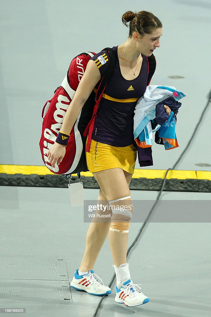 Andrea Petkovic of Germany leaves the court after conceding her group A singles match Ashleigh Barty of Australia due to a knee injury that she suffered during the game on day one of the Hopman Cup at Perth Arena on December 29, 2012 in Perth, Australia.