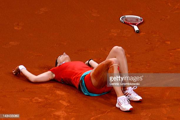 Andrea Petkovic of Germany lies on the court after suffering an injury in her match against Victoria Azarenka of Belarus during day four of the WTA...
