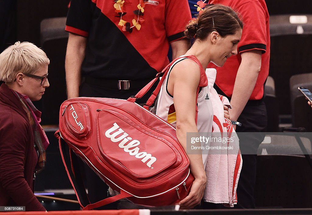 <a gi-track='captionPersonalityLinkClicked' href=/galleries/search?phrase=Andrea+Petkovic&family=editorial&specificpeople=4253746 ng-click='$event.stopPropagation()'>Andrea Petkovic</a> of Germany looks dejected as she leaves the court after her defeat during Day 1 of the 2016 Fed Cup World Group First Round match between Germany and Switzerland at Messe Leipzig on February 6, 2016 in Leipzig, Germany.