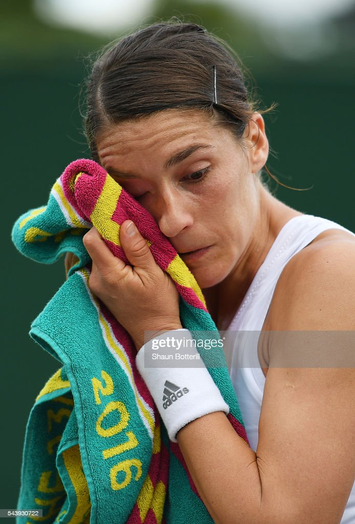 <a gi-track='captionPersonalityLinkClicked' href=/galleries/search?phrase=Andrea+Petkovic&family=editorial&specificpeople=4253746 ng-click='$event.stopPropagation()'>Andrea Petkovic</a> of Germany looks dejected during the Ladies Singles second round match against Elena Vesnina of Russia on day four of the Wimbledon Lawn Tennis Championships at the All England Lawn Tennis and Croquet Club on June 30, 2016 in London, England.