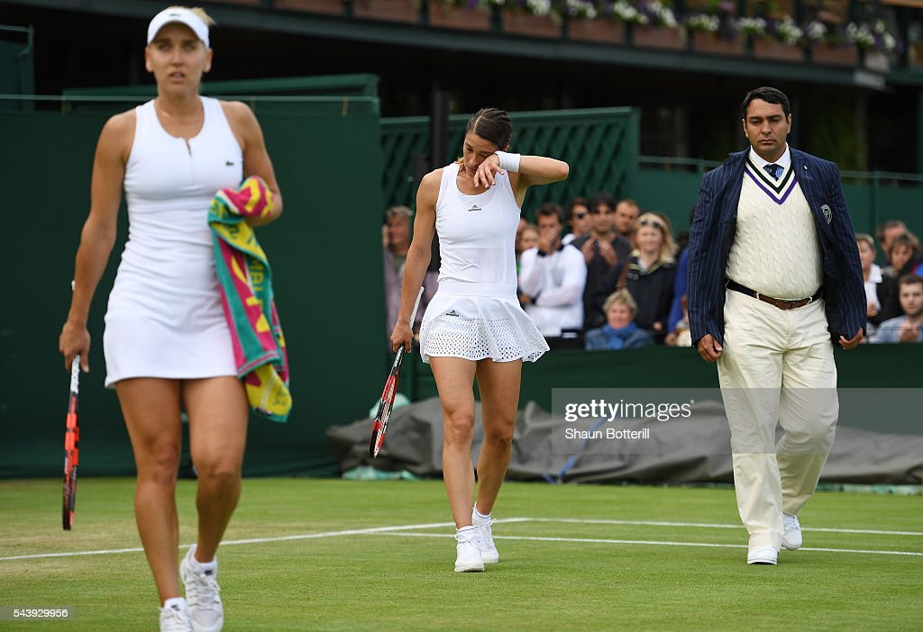 <a gi-track='captionPersonalityLinkClicked' href=/galleries/search?phrase=Andrea+Petkovic&family=editorial&specificpeople=4253746 ng-click='$event.stopPropagation()'>Andrea Petkovic</a> of Germany looks dejected following defeat during the Ladies Singles second round match against Elena Vesnina of Russia on day four of the Wimbledon Lawn Tennis Championships at the All England Lawn Tennis and Croquet Club on June 30, 2016 in London, England.