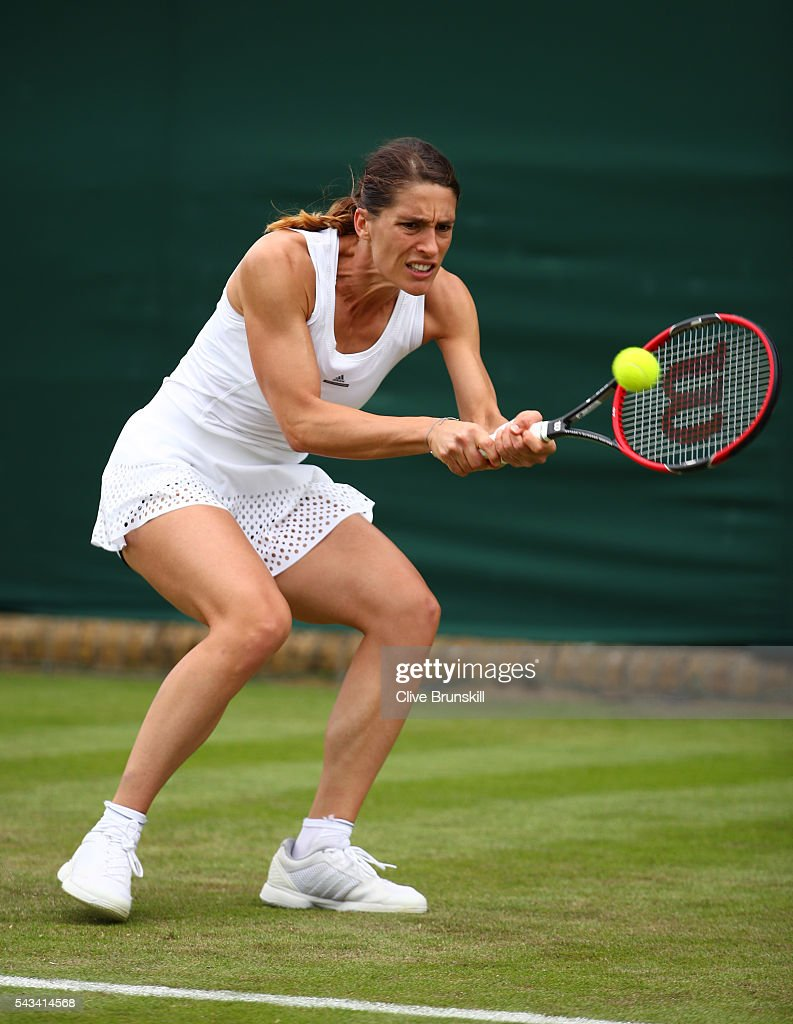 <a gi-track='captionPersonalityLinkClicked' href=/galleries/search?phrase=Andrea+Petkovic&family=editorial&specificpeople=4253746 ng-click='$event.stopPropagation()'>Andrea Petkovic</a> of Germany plays a backhand during the Ladies Singles first round match against Nao Hibino of Japan on day two of the Wimbledon Lawn Tennis Championships at the All England Lawn Tennis and Croquet Club on June 28, 2016 in London, England.