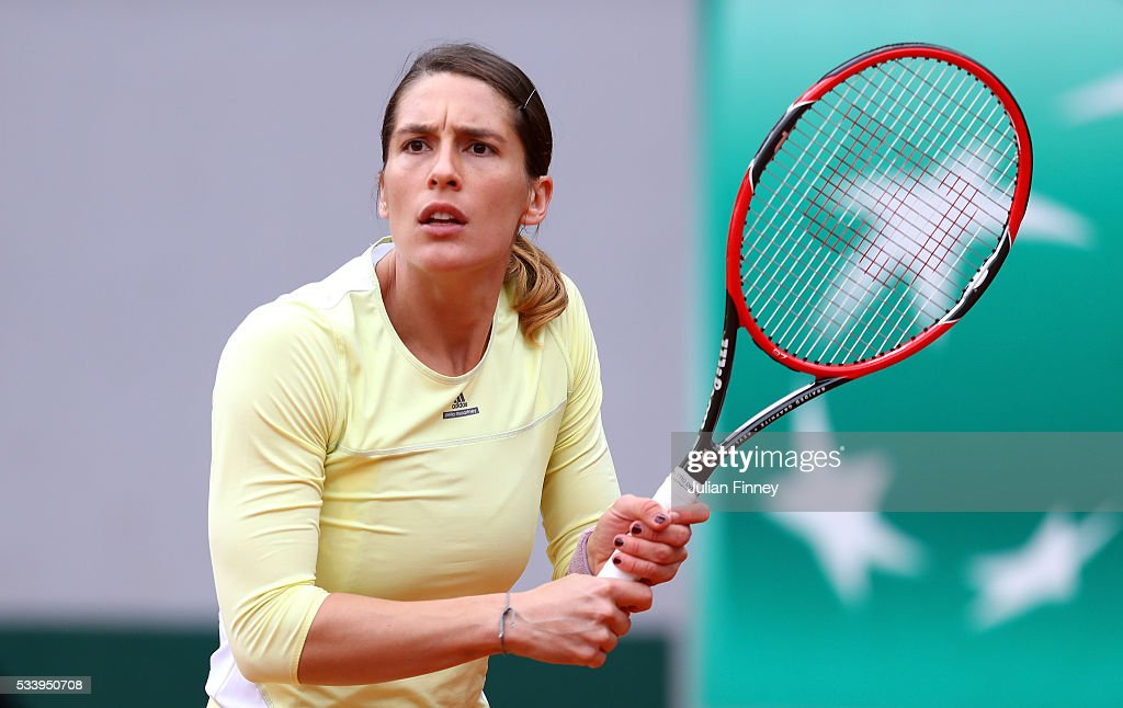 Andrea Petkovic of Germany plays a backhand during the Women's Singles first round match against Laura Robson of Great Britain on day three of the 2016 French Open at Roland Garros on May 24, 2016 in Paris, France.