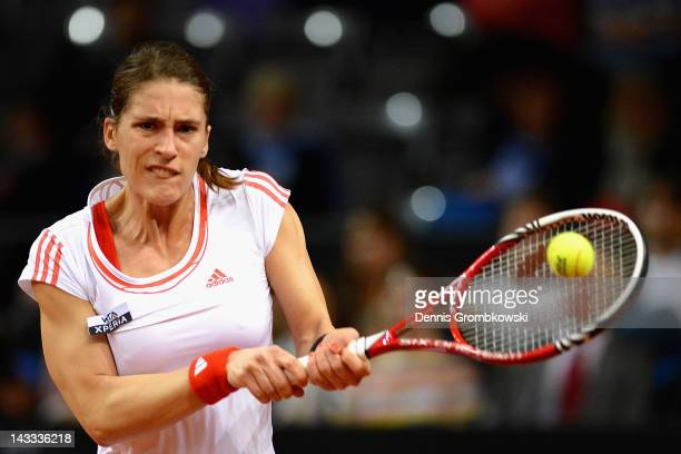 Andrea Petkovic of Germany plays a backhand in her match against Kristina Barrois of Germany during day two of the WTA Porsche Tennis Grand Prix at...