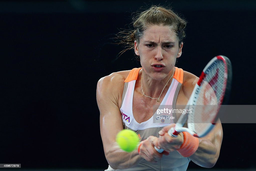 <a gi-track='captionPersonalityLinkClicked' href=/galleries/search?phrase=Andrea+Petkovic&family=editorial&specificpeople=4253746 ng-click='$event.stopPropagation()'>Andrea Petkovic</a> of Germany plays a backhand in her match against Bethanie Mattek-Sands of the USA during day one of the 2014 Brisbane International at Queensland Tennis Centre on December 29, 2013 in Brisbane, Australia.