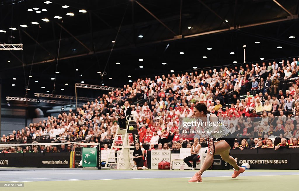 <a gi-track='captionPersonalityLinkClicked' href=/galleries/search?phrase=Andrea+Petkovic&family=editorial&specificpeople=4253746 ng-click='$event.stopPropagation()'>Andrea Petkovic</a> of Germany plays a backhand in her match against Belinda Bencic of Switzerland during Day 1 of the 2016 Fed Cup World Group First Round match between Germany and Switzerland at Messe Leipzig on February 6, 2016 in Leipzig, Germany.
