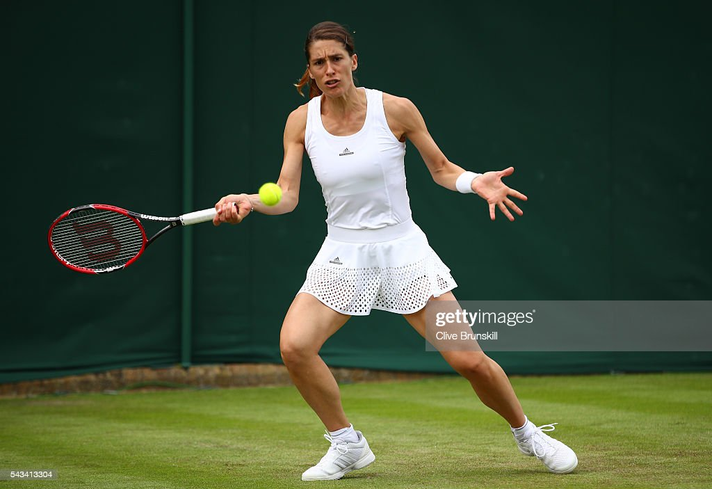 <a gi-track='captionPersonalityLinkClicked' href=/galleries/search?phrase=Andrea+Petkovic&family=editorial&specificpeople=4253746 ng-click='$event.stopPropagation()'>Andrea Petkovic</a> of Germany plays a forehand during the Ladies Singles first round match against Nao Hibino of Japan on day two of the Wimbledon Lawn Tennis Championships at the All England Lawn Tennis and Croquet Club on June 28, 2016 in London, England.