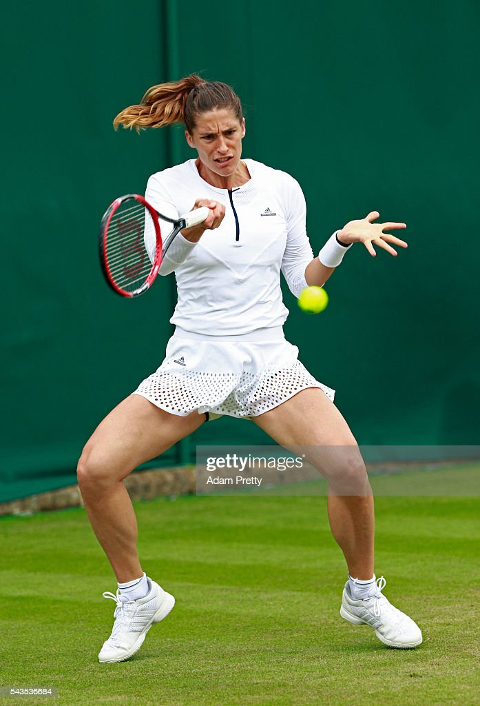<a gi-track='captionPersonalityLinkClicked' href=/galleries/search?phrase=Andrea+Petkovic&family=editorial&specificpeople=4253746 ng-click='$event.stopPropagation()'>Andrea Petkovic</a> of Germany plays a forehand during the Ladies Singles first round match against Nao Hibino of Japan on day three of the Wimbledon Lawn Tennis Championships at the All England Lawn Tennis and Croquet Club on June 29, 2016 in London, England.