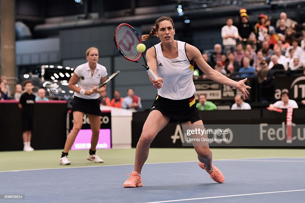 <a gi-track='captionPersonalityLinkClicked' href=/galleries/search?phrase=Andrea+Petkovic&family=editorial&specificpeople=4253746 ng-click='$event.stopPropagation()'>Andrea Petkovic</a> of Germany plays a forehand in her double match with Anna-Lena Groenefeld on Day 2 of the 2016 FedCup World Group Round 1 match between Germany and Switzerland at Messe Leipzig on February 7, 2016 in Leipzig, Germany.