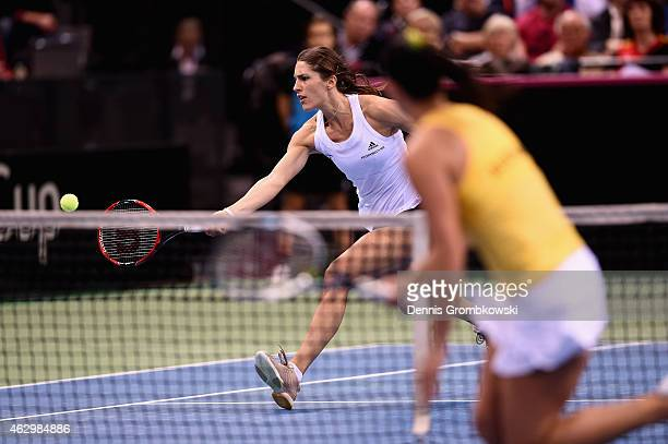 Andrea Petkovic of Germany plays a forehand in her single match against Jarmila Gajdosova of Australia during the Fed Cup 2015 World Group First...