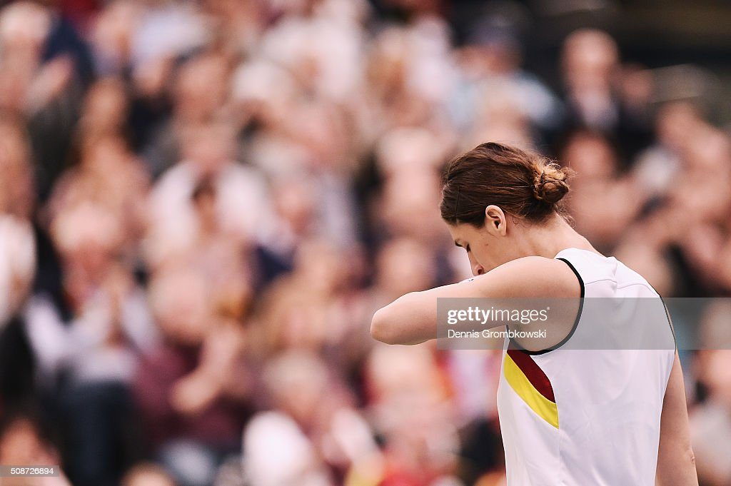 <a gi-track='captionPersonalityLinkClicked' href=/galleries/search?phrase=Andrea+Petkovic&family=editorial&specificpeople=4253746 ng-click='$event.stopPropagation()'>Andrea Petkovic</a> of Germany reacts during her match against Belinda Bencic of Switzerland during Day 1 of the 2016 Fed Cup World Group First Round match between Germany and Switzerland at Messe Leipzig on February 6, 2016 in Leipzig, Germany.
