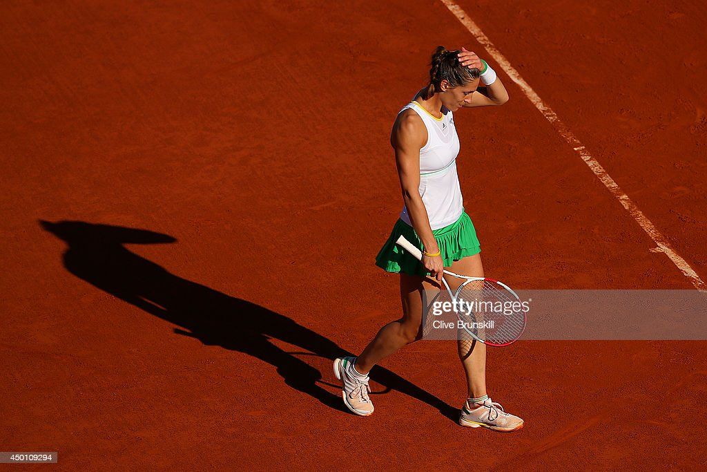Andrea Petkovic of Germany reacts during her women's singles match against Simona Halep of Romania on day twelve of the French Open at Roland Garros on June 5, 2014 in Paris, France.