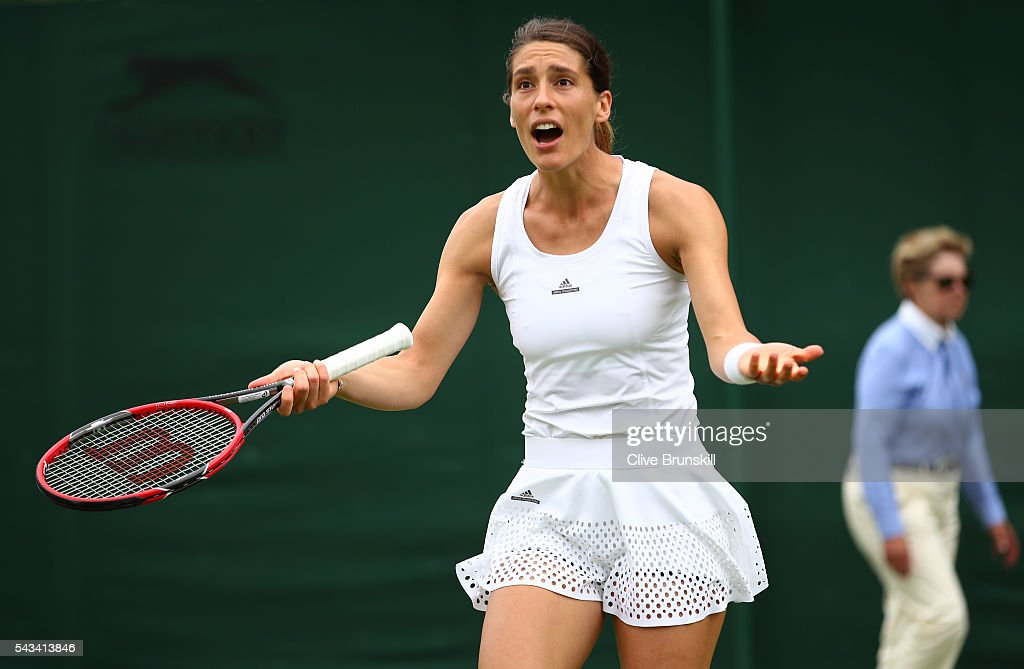 <a gi-track='captionPersonalityLinkClicked' href=/galleries/search?phrase=Andrea+Petkovic&family=editorial&specificpeople=4253746 ng-click='$event.stopPropagation()'>Andrea Petkovic</a> of Germany reacts during the Ladies Singles first round match against Nao Hibino of Japan on day two of the Wimbledon Lawn Tennis Championships at the All England Lawn Tennis and Croquet Club on June 28, 2016 in London, England.