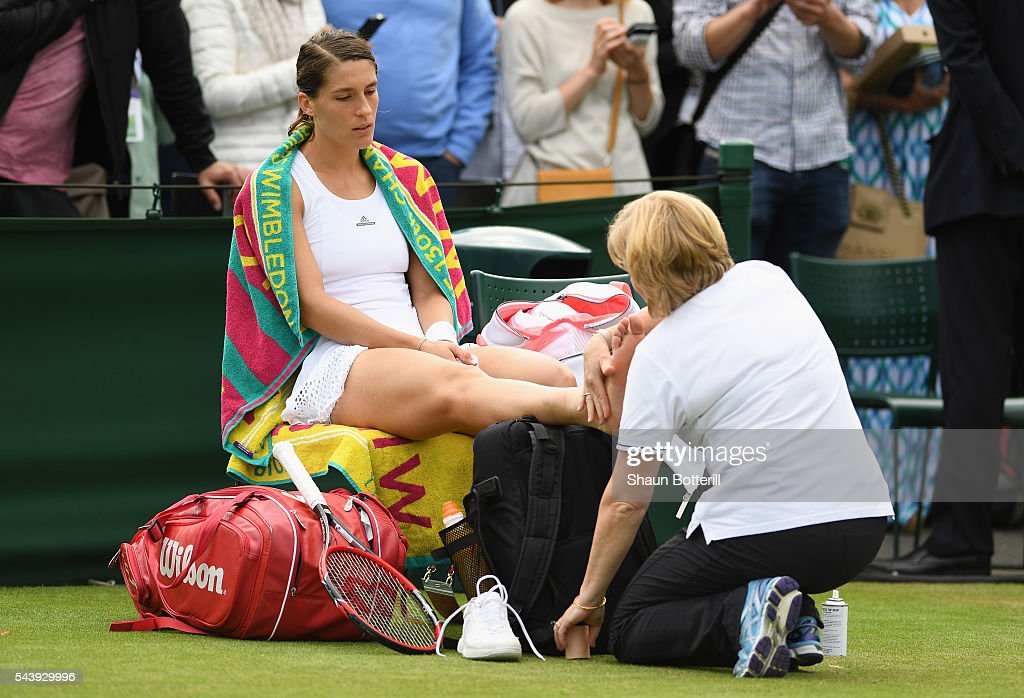 <a gi-track='captionPersonalityLinkClicked' href=/galleries/search?phrase=Andrea+Petkovic&family=editorial&specificpeople=4253746 ng-click='$event.stopPropagation()'>Andrea Petkovic</a> of Germany recieves physio treatment during the Ladies Singles second round match against Elena Vesnina of Russia on day four of the Wimbledon Lawn Tennis Championships at the All England Lawn Tennis and Croquet Club on June 30, 2016 in London, England.