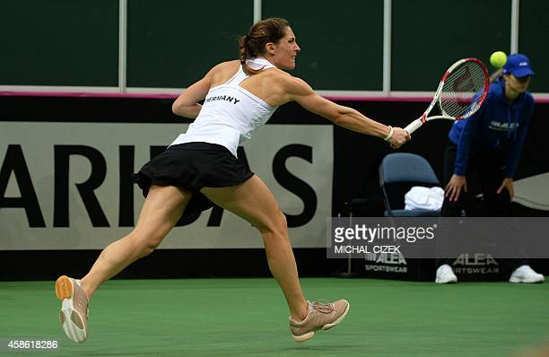 Andrea Petkovic of Germany returns a ball to Petra Kvitova of Czech Republic during the International Tennis Federation Fed Cup final match Czech...