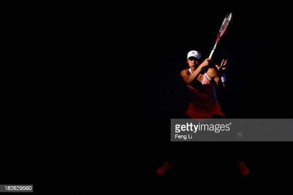Andrea Petkovic of Germany returns a shot during her women's singles match against Svetlana Kuznetsova of Russia on day five of the 2013 China Open...