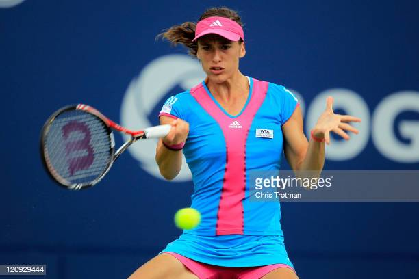 Andrea Petkovic of Germany returns a shot to Agnieszka Radwanska of Poland on Day 5 of the Rogers Cup presented by National Bank at the Rexall Centre...