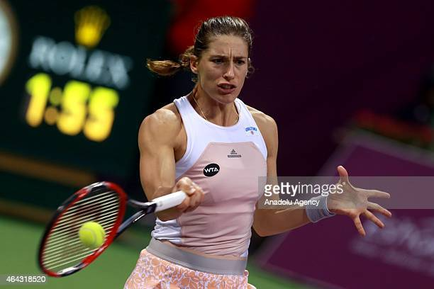 Andrea Petkovic of Germany returns the ball against Kirsten Flipkens of Belgium during Qatar Total Open 2015 at Khalifa International Tennis Complex...