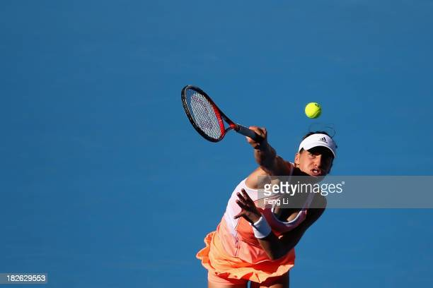 Andrea Petkovic of Germany serves during her women's singles match against Svetlana Kuznetsova of Russia on day five of the 2013 China Open at the...