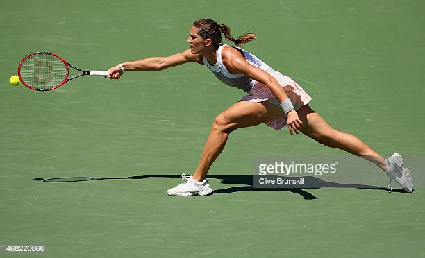 Andrea Petkovic of Germany stretches to play a forehand against Karolina Pliskova of the Czech Republic in their quarter final match during the Miami...