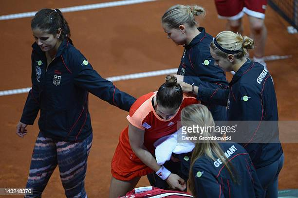 Andrea Petkovic of Germany takes comfort of her teammates after being defeated by Samantha Stosur of Australia during day two of the Federation Cup...