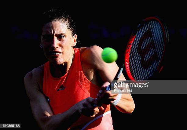 Andrea Petkovic plays a backhand in her match against Camila Giorgi of Italy during day one of the WTA Dubai Duty Free Tennis Championship at the...