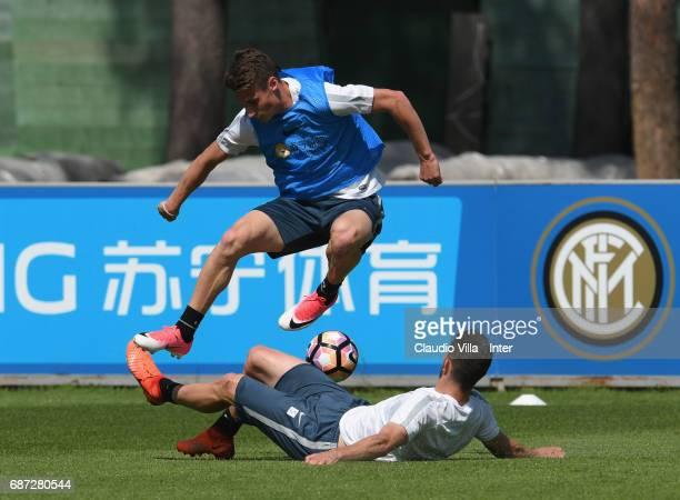 Andrea Pinamonti and Roberto Gagliardini of FC Internazionale of FC Internazionale compete for the ball during FC Internazionale training session at...
