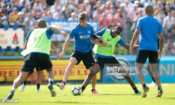 Andrea Pinamonti competes for the ball with Geoffrey Kondogbia during the FC Internazionale training session on July 12 2017 in Reischach near...