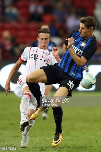Andrea Pinamonti of FC Internazionale holds off Marco Friedl of FC Bayern during the International Champions Cup match between FC Bayern and FC...