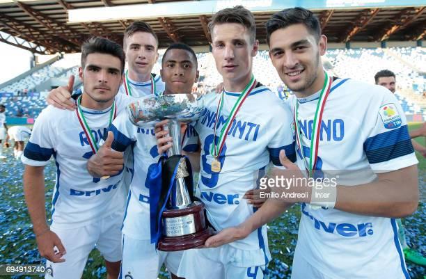 Andrea Pinamonti of FC Internazionale Milano celebrates the victory with his teammates Andrea Cagnano and Rigo Berto Rivas and Matteo Rover at the...