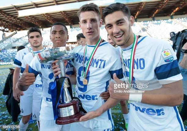 Andrea Pinamonti of FC Internazionale Milano celebrates the victory with his teammates Andrea Cagnano and Rigo Berto Rivas at the end of the...