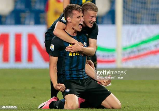 Andrea Pinamonti of FC Internazionale Milano celebrates their victory with his team mate Xian Ghislaine Emmers at the end of the Primavera TIM...