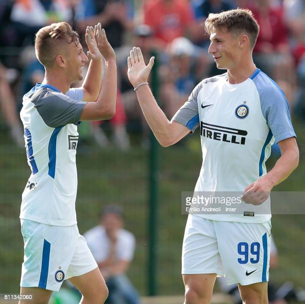 Andrea Pinamonti of FC Internazionale Milano celebrates with his teammate Marco Sala after scoring the opening goal during the Preseason Friendly...